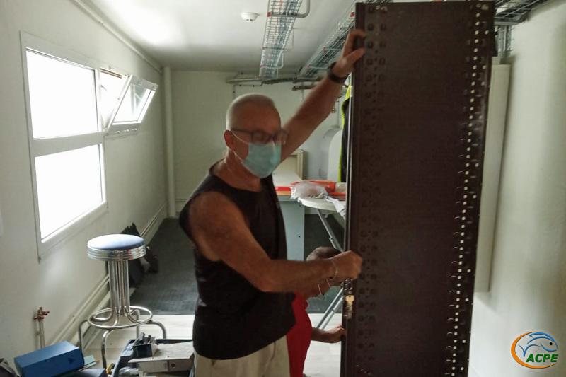 Dimanche 4 juillet, remontage d'étagères dans le nouvel atelier.